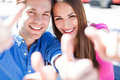 Couple with thumbs up smiling Royalty Free Stock Image