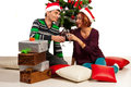 Couple toasting champagne and celebrate christmas in their home Royalty Free Stock Image