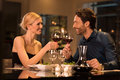 Couple toasting wineglasses romantic young at restaurant raising a toast beautiful with glasses of red wine in restaurant wine Royalty Free Stock Images