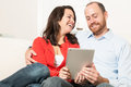 Couple together having fun in the living room Stock Image