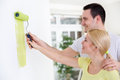 Couple together painting wall young with paint roller Royalty Free Stock Photography