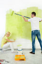 Couple together painting wall young in their flat Royalty Free Stock Image