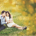 Couple together spending great time in garden Royalty Free Stock Photography