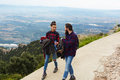 A couple of tourists coming down from the picturesque hill Royalty Free Stock Photo
