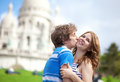 Couple of tourists kissing by Sacre-Coeur Stock Photo