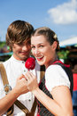 Couple in Tracht on Dult or Oktoberfest Royalty Free Stock Image