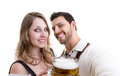 Couple in traditional bavarian costume on white background Royalty Free Stock Photo