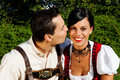 Couple in traditional Bavarian dress in summer Stock Images