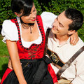 Couple in traditional Bavarian dress in summer Royalty Free Stock Images