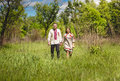 Couple in traditional slavic clothes walking at meadow beautiful Royalty Free Stock Photography