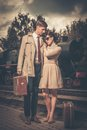 Couple on a train station beautiful vintage style with suitcases platform Royalty Free Stock Photo