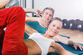 Couple training sit ups in sport gym Royalty Free Stock Image