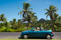 Couple travel by car in tropical island rarotonga sep rarotonga on sep cooks islands are largely unspoiled tourism with visitors a Stock Photo