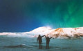 Couple Travelers enjoying Northern lights Royalty Free Stock Photo