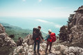 Couple travelers Man and Woman holding hands enjoying mountains aerial view Royalty Free Stock Photo