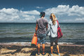 Couple Travelers Man And Woman Standing On Seashore Adventure Travel Relax Concept Royalty Free Stock Photo