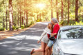 Couple traveling by car in the forest Royalty Free Stock Photo