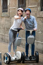 Couple traveling by segways