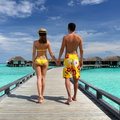 Couple tropical beach jetty maldives Royalty Free Stock Image