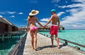 Couple on a tropical beach jetty at maldives Royalty Free Stock Photos