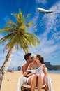 Couple on the tropical beach at resort travel concept Royalty Free Stock Photos