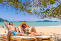 Couple on the tropical beach at resort travel concept Royalty Free Stock Photo