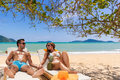 Couple on the tropical beach at resort travel concept Stock Photography