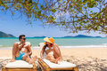 Couple on the tropical beach at resort travel concept Stock Photos