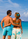 Couple on the tropical beach at resort travel concept Royalty Free Stock Photography