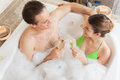 Couple in the tub toasting young love making a toast Stock Image