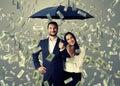 Couple under money rain Royalty Free Stock Photo
