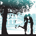 Couple under the tree in city  Royalty Free Stock Image