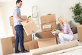 Couple unpack moving boxes a young Stock Images