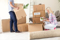 Couple unpack moving boxes young unpacking in new home Royalty Free Stock Photography