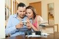 Couple unpacking new compact digital camera Royalty Free Stock Photo