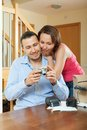 Couple unpacking new compact digital camera Royalty Free Stock Photo