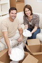 Couple Unpacking or Packing Boxes Moving House Royalty Free Stock Image
