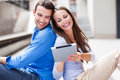 Couple using digital tablet outdoors Royalty Free Stock Photo