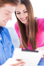 Couple using digital tablet young Royalty Free Stock Photos