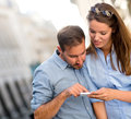 Couple using a GPS device Royalty Free Stock Photo