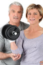 Couple using gym weights Stock Photo