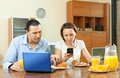 Couple using laptop during breakfast at home casual electronic devices Stock Photography