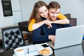 Couple using laptop computer at home Royalty Free Stock Photo