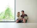 Couple using laptop on the floor at home Royalty Free Stock Photo