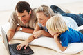 image photo : Couple using laptop with kid