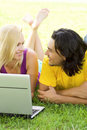 Couple using laptop outdoors Royalty Free Stock Images