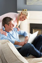 Couple Using Laptop Relaxing Sitting On Sofa Stock Photography