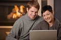 Couple using laptop at winter Stock Image