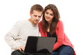Couple using laptop young surfing the internet on a Royalty Free Stock Images