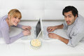 Couple using laptops Royalty Free Stock Photo